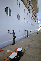 Cruise Ship Undergoing Paint touch-up in Caribbean Port