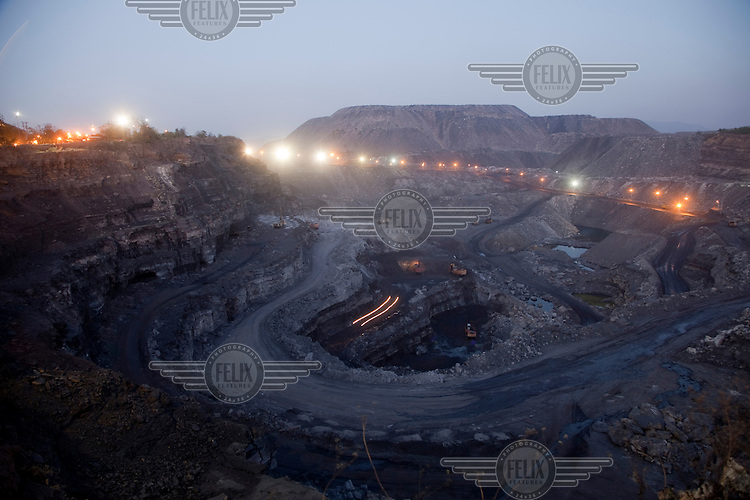 West Bokaro open cast coal mine owned by Tata Steel, India's largest private steel company. The mine was hewn from land that formerly supported forests and agricultural land where Adivasi tribal people had farmed or led a hunter-gatherer life for thousands of years..