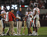 Ole Miss quarterback Jeremiah Masoli (8) talks with Ole Miss Head Coach Houston Nutt at Bryant-Denny Stadium in Tuscaloosa, Ala.  on Saturday, October 16, 2010. Alabama won 23-10.