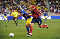 Timmy Chandler (3)  of the United States and Cristian Suarez (13)  of Ecuador. The men's national team of the United States (USA) was defeated by Ecuador (ECU) 1-0 during an international friendly at Red Bull Arena in Harrison, NJ, on October 11, 2011.