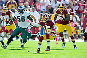 Washington Redskins kick returner Brandon Banks (16) tries to cut on a return in the first quarter against the Philadelphia Eagles  at FedEx Field in Landover, Maryland on Sunday, October 16, 2011. Eagles linebacker Akeem Jordan (56) defends on the play.  Redskins linebacker Keyaron Fox (51) follows on the play.  The Eagles won the game 20 - 13..Credit: Ron Sachs / CNP