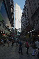 The view from Nathan Road of Kowloon residential highrise The Masterpiece (completed 2007) adjacent to much older Carnarvon Road buildings