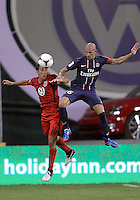 WASHINGTON, DC - July 28, 2012:  Josh Wolff (16) of DC United loses a header to Christophe Jallet (26) of PSG (Paris Saint-Germain) in an international friendly match at RFK Stadium in Washington DC on July 28. The game ended in a 1-1 tie.