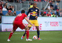 Toronto, Ontario - May 17, 2014: New York Red Bulls forward Thierry Henry #14 and Toronto FC defender Bradley Orr #16 in action during the second half in a game between the New York Red Bulls and Toronto FC at BMO Field. Toronto FC won 2-0.