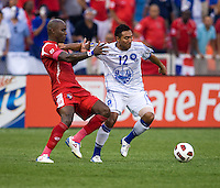 Felipe Baloy (23) of Panama fights for the ball with Arturo Alvarez (12) of El Salvador  during the game at RFK Stadium in Washington, DC.  Panama defeated El Salvador on penalty kicks, 5-3, after tying, 1-1,  in regulation time.