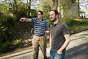 Realtor Ken Gasch speaks with Jeremiah Hinson, a potential buyer from Chapel Hill, as they walk through  the Cleveland-Holloway neighborhood in Durham, NC, Friday, April 11, 2008.