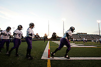 The Dallas Diamonds' Jessica Springer (right) and other players warm up before the team's 34-27 win against the Houston Energy in the Women's Professional Football League championship. Springer is both a fullback and a linebacker.<br />
