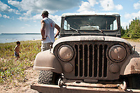 Joe Chmelar of Norton Shores Michigan in his 1978 Jeep he and his son drove during the 2010 U.P. Overland trip in the Upper Peninsula of Michigan.