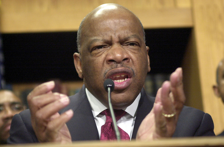 6cbc030801 -- Rep. John Lewis, D-GA, with the Congressional Black Caucus at a press conference opposing the President's tax plan.