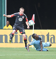 Taylor Kemp (33) of D.C. United goes against Sporting Kansas City Mechack Jerome (24)  D.C. United tied The Sporting Kansas City 1-1, at RFK Stadium, Sunday May 19, 2013.