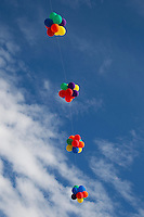 balloons tied to a string  and floating in the sky