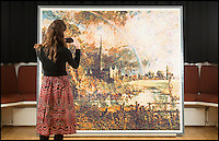 BNPS.co.uk (01202 558833)<br /> Pic: TomWren/BNPS<br /> <br /> Aspire trainee Nicola Trowell inspects the Lego Constable.<br /> <br /> Lego-lovers have recreated one of John Constable's most famous paintings with 65,000 tiny building blocks. <br /> <br /> The unusual replica of Constable's 1831 work 'Salisbury Cathedral from the Meadows' has been put together in celebration of the original's arrival at the Salisbury Museum in Wiltshire. <br /> <br /> About 800 volunteers flocked to the museum earlier this week to empty out the giant sacks of Lego and put the puzzle together