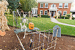 A family goes all out with creative Halloween decorations in the front yard.