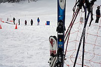 "Beginning skiers ride the ""magic carpet"" lift on the bunny hill at Showdown Ski Area on King's Hill in the Little Belt Mountains near Neihart, Montana, USA."