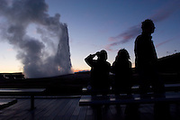 Park visitors watch a twilight eruption of the Old Faithful geyser in Yellowstone National Park, Monday, May 30, 2005. (Kevin Moloney for the New York Times)