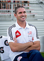 New England Revolution head coach Jay Heaps sits on the bench before the quarterfinals of the US Open Cup at the Maryland SoccerPlex in Boyds, Md.  D.C. United defeated the New England Revolution, 3-1.