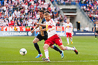 Markus Holgersson (5) of the New York Red Bulls and Sebastien Le Toux (11) of the Philadelphia Union. The New York Red Bulls defeated the Philadelphia Union 2-1 during a Major League Soccer (MLS) match at Red Bull Arena in Harrison, NJ, on March 30, 2013.