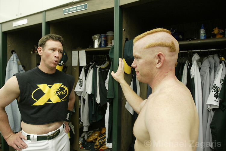 OAKLAND, CA - JUNE 5:  Damian Miller and Bobby Kielty of the Oakland Athletics before the MLB game against the Toronto Blue Jays at Network Associates Coliseum on June 5, 2004 in Oakland, California. The A's defeated the Blue Jays 4-0. (Photo by Michael Zagaris/MLB Photos via Getty Images)