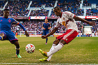 Marvin Chavez (18) of the Colorado Rapids defends the cross of Roy Miller (7) of the New York Red Bulls. The New York Red Bulls and the Colorado Rapids played to a 1-1 tie during a Major League Soccer (MLS) match at Red Bull Arena in Harrison, NJ, on March 15, 2014.