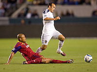 Real Salt Lake midfielder Andy Williams (77) attempts a tackle on LA Galaxy forward Landon Donovan (10). The LA Galaxy defeated Real Salt Lake 2-1 at Home Depot Center stadium in Carson, California on Saturday April 17, 2010.  .