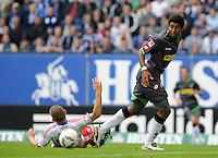 FUSSBALL   1. BUNDESLIGA   SAISON 2011/2012    6. SPIELTAG Hamburger SV - Borussia Moenchengladbach            17.09.2011 Mladen PETRIC (li, Hamburg) gegen DANTE (re, Moenchengladbach)