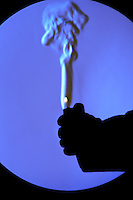 A schlieren image of a gas handheld lighter being ignited.  The schlieren images identifies areas of different temperature by using the change in the index of refraction of a fluid due to a change in temperature.