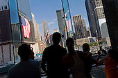 New  York, New York.September 10, 2011..Views of Ground Zero on the eve of the 10th anniversary of 9-11-2001. People look down at the site from Three World Financial Center.
