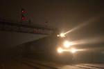 Its headlight slicing through the thick-as-pea-soup fog, a Metra Heritage corridor commuter train pulls into its last stop of the night, Joliet, IL.