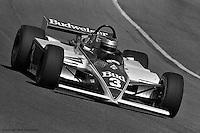 HAMPTON, GA - APRIL 17: Mario Andretti drives his  Lola T700/Cosworth during practice for the Kraco Dixie 200 on April 17, 1983, at the Atlanta Motor Speedway near Hampton, Georgia.