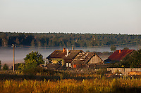 Korovikha, Ivanova Region, Russia, 06/08/2012..Wooden homes in the village of Korovikha,  some 200 miles east of Moscow, shrouded in mist at dawn.