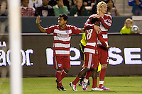 FC Dallas players David Ferreira (l), Marvin Chavez (c) and Brek Shea (tall guy) celebrate a Marvin Chavez goal. FC Dallas defeated the LA Galaxy 3-0 to win the Western Division 2010 MLS Championship at Home Depot Center stadium in Carson, California on Sunday November 14, 2010.