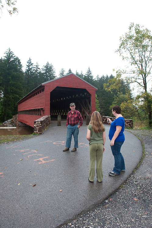 UNITED STATES -Sept 27: Visitors at the Sauches Covered Bridge check out the high water from all the rain the area has received the last couple of days. The bridge is a 100-foot, Town truss covered bridge over Marsh Creek between Cumberland and Freedom Townships, in Adams County Pennsylvania. The bridge was also known as the Sauches Covered Bridge at the time of the Battle of Gettysburg. It is located in the Gettysburg National Military Park and was listed on the National Register of Historic Places in 1980. During the American Civil War, both the Union and Confederate Armies used the bridge in the Battle of Gettysburg and its aftermath. (Photo By Douglas Graham/Roll Call )