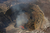 Pit crater containing lava lake in Santiago Crater of erupting Masaya Volcano, Nicaragua