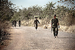 Thai military patrol their side of the &quot;White Zone,&quot; a heavily mined buffer between Cambodia and Thailand through which undocumented migrants regularly pass.
