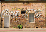 Coca-cola and Carnation signs painted on side of the old brick building (Newman Store), Ione, Amador County, Calif.