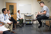 From left, Andrew Nobe, Jennifer Hughes, Elizabeth Abernathy, and standardized patient Maxx Vick. Class of 2015 students work with standardized patients. Taking sexual histories.