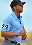 13 March 2012: Umpire C.B. Bucknor trots to his position during a Spring Training game between the Miami Marlins and the Atlanta Braves at Roger Dean Stadium in Jupiter, Florida. The two teams battled to a 2-2 tie playing 10 innings of Grapefruit League action. Mandatory Credit: Ed Wolfstein Photo