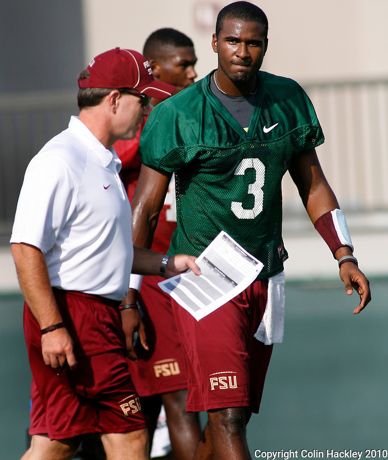 TALLAHASSEE, FL 8/5/10 FSU 080510 CH-Florida State Head Coach Jimbo Fisher, left, talks with EJ Manuel during the first day of practice Thursday in Tallahassee. .COLIN HACKLEY PHOTO