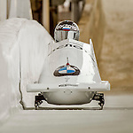 8 January 2016: Alexander Kasjanov, piloting his 2-man bobsled for Russia, enters the Chicane straightaway on his second run, ending the day with a combined 2-run time of 1:51.63 and earning a 13th place finish at the BMW IBSF World Cup Championships at the Olympic Sports Track in Lake Placid, New York, USA. Mandatory Credit: Ed Wolfstein Photo *** RAW (NEF) Image File Available ***