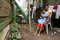A mother and son in Tallo, Makassar, Sulawesi, Indonesia.