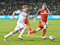 CARSON, CA – June 11, 2011: LA Galaxy midfielder Chris Birchall (8) attempts to move past Toronto FC defender Ty Harden (20) during the match between LA Galaxy and Toronto FC at the Home Depot Center in Carson, California. Final score LA Galaxy 2, Toronto FC 2.