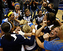 UCLA players celebrate after defeating Illinois in the 2011 NCAA Division I Women's Volleyball National Championship Match at the Alamodome on Saturday, Dec. 17, 2011. UCLA won in four sets, 25-23, 23-25, 26-24, 25-16.