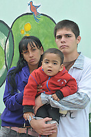 17-years-old Daniel Ojeda, fighting against adiction, his girlfriend Daniel Franco (18) and their son Luciano (1 year-old) at the Asociacion Civil headquarters