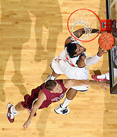 Nov 6, 2010; Charlottesville, VA, USA; Virginia Cavaliers f Mike Scott (23) shoots the ball in front of Roanoke College f Joey Leech (42) Saturday afternoon in exhibition action at John Paul Jones Arena. The Virginia men's basketball team recorded an 82-50 victory over Roanoke College.