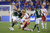 Kenny Cooper (33) of the Portland Timbers and Stephen Keel (22) of the New York Red Bulls look to play the ball. The New York Red Bulls defeated the Portland Timbers 2-0 during a Major League Soccer (MLS) match at Red Bull Arena in Harrison, NJ, on September 24, 2011.