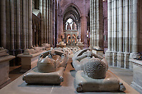 Nave with statues-gisants of Louis of France (1276 - 1319) and Marguerite of Artois (1285 - 1311) in the foreground, marble, 14th century, origine Church of Jacobins (Paris), funerary Monument of Louis XII and Anne of Brittany in the distance, Abbey church of Saint Denis, Seine Saint Denis, France. Picture by Manuel Cohen