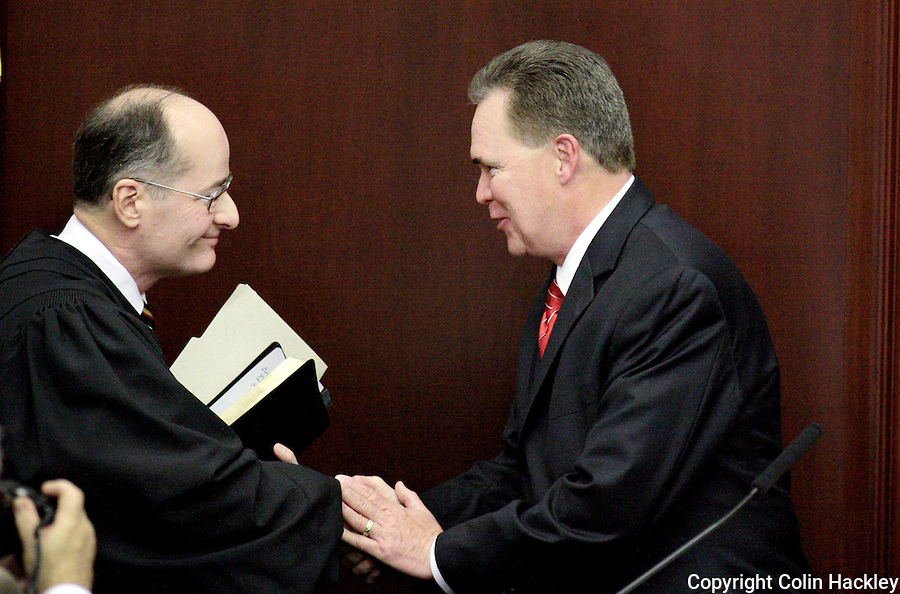 TALLAHASSEE, FL. 3/3/09-REAGAN-CH3-Rep. Ron Reagan, R-Bradenton, right, is congratulated on becoming Speaker Pro-Tempore by Florida Supreme Court Justice Charles Canady, March 3, 2009 at the Capitol in Tallahassee...COLIN HACKLEY PHOTO