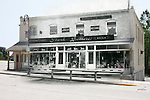 Composite image of a historical Stark Brothers Dry Goods Store with a boardwalk over a present day commerical clothing shop Dans Tog Shop and Robin's Nest in Menomonee Falls WI