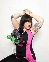 Malicen Thunderland, of the roller derby team, the Boston Derby Dames. Roller derby is an American contact sport, popular with young women, which combines both athleticism and a satirical punk third-wave feminism aesthetic.