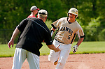 BEACON FALLS,  CT-051817JS31-Woodland's Matt Szturma (5) round third on his way home after blasting a two run home-run during their game against Wolcott Thursday at Woodland Regional High School in Beacon Falls. <br /> Jim Shannon Republican-American